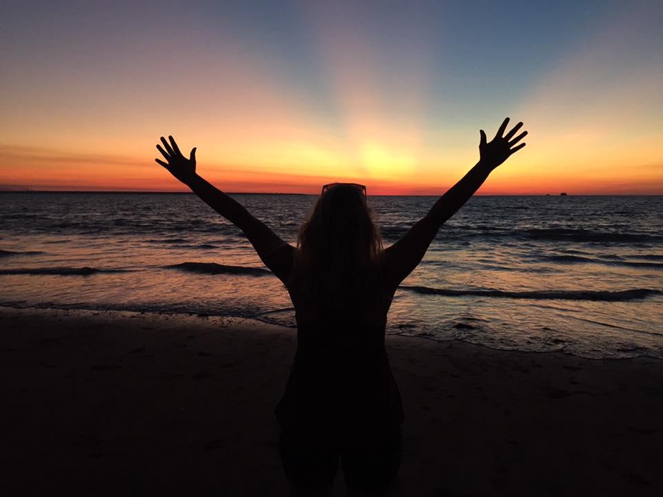 Kayla at sunset on Mindil Beach in Darwin
