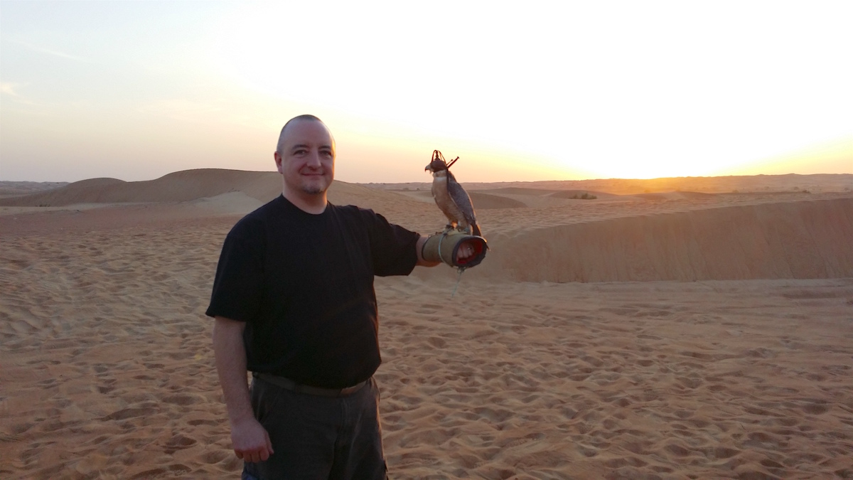 Phil Gain - Phil and a falcon in the United Arab Emirates